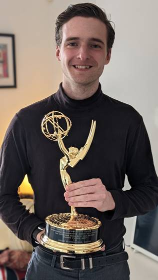 Oscar holding his emmy